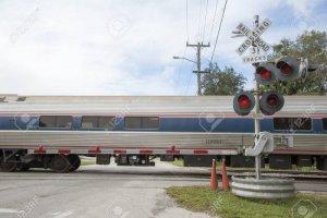 24010833-amtrak-passenger-train-passing-level-crossing-at-deland-florida-usa.jpg