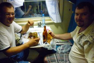 2010 Russia 269k eating in compartment.jpg