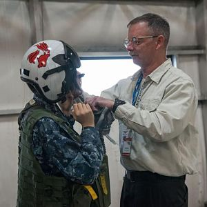 Sea Cadet putting on all the flight gear, from helmet to speed jeans.  Photo by Kyra Betteridge