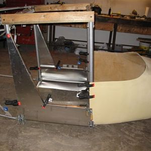 Fiberglass pilot enclosure which is awaiting to be riveted to the forward roll cage.